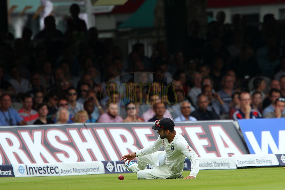 Virat Kohli of India saves the boundary during day three of the 2nd Investec test match between England and India held at Lords cricket ground in London, England on the 19th July 2014<br /> <br /> Photo by Ron Gaunt / SPORTZPICS/ BCCI