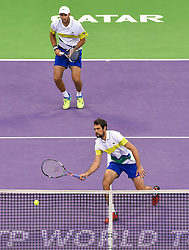 Jeremy Chardy (bottom) and Fabrice Martin (top) of France in action against Vasek Pospisil of Canada and Radek Stepanek of Czech Republic during the ATP Qatar Open Tennis tournament doubles final at the Khalifa International Tennis Complex in Doha, capital of Qatar, on January 06, 2017. Jeremy Chardy and his teammate Fabrice Martin became won the title 2-0. (Credit Image: © Nikku/Xinhua via ZUMA Wire)