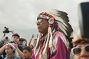 Arvol Looking Horse, a Sioux spiritual leader, looks on as a group of canoes arrives in a protest camp that sprang up to demonstrate against the Energy Transfer Partners' Dakota Access oil pipeline near the Standing Rock Sioux reservation in Cannon Ball, North Dakota. The canoe flotilla had representatives of tribes from the across the Pacific Northwest and navigated the Missouri River from Bismarck to Cannon Ball to show their support.