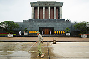 08 APRIL 2012 - HANOI, VIETNAM:    Cleaning crews work in the public square in front of the Ho Chi Minh Mausoleum in Hanoi. The Ho Chi Minh Mausoleum, in Vietnamese: Lng Ch tch H Chí Minh, is a large memorial in Hanoi, Vietnam dedicated to Ho Chi Minh, the late leader of North Vietnam. It is located in the centre of Ba Dinh Square, which is the place where Ho read the Declaration of Independence on September 2, 1945, establishing the Democratic Republic of Vietnam. The mausoleum is 21.6 metres high and 41.2 metres wide.      PHOTO BY JACK KURTZ