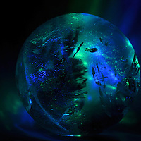 Quartz crystal sphere with turquoise moods