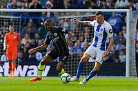 BRIGHTON, ENGLAND - MAY 12:   Raheem Sterling (7) of Manchester City battles for possession with Pascal Gross (13) of Brighton and Hove Albion during the Premier League match between Brighton & Hove Albion and Manchester City at American Express Community Stadium on May 12, 2019 in Brighton, United Kingdom. (MB Media)