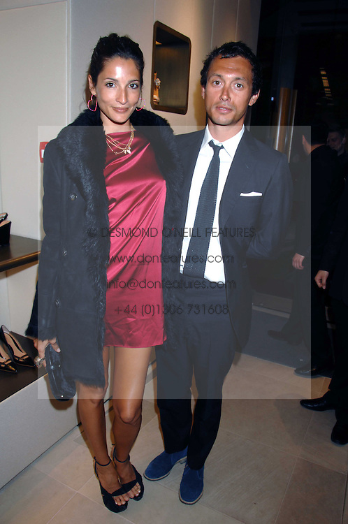 VISCOUNT MACMILLAN and ASTRID MUNOZ at a party at shoe store Sergio Rossi, 207 Sloane Street, London on 4th April 2007.<br />