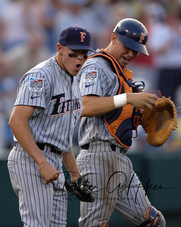 Cal State Fullerton's Wes Roemer (L) is pumped, along with catcher John Curtis (R), after closing out the game with Clemson with a win.  Cal State Fullerton eliminated Clemson from the College World Series with a 7-6 win at Rosenblatt Stadium in Omaha, Nebraska, June 20, 2006.