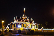 "01 FEBRUARY 2013 - PHNOM PENH, CAMBODIA: The Royal Palace in Phnom Penh is lit up and adorned with a photo of former King Norodom Sihanouk early in the morning of Feb 1, before Sihanouk's funeral procession left the palace. Norodom Sihanouk (31 October 1922 - 15 October 2012) was the King of Cambodia from 1941 to 1955 and again from 1993 to 2004. He was the effective ruler of Cambodia from 1953 to 1970. After his second abdication in 2004, he was given the honorific of ""The King-Father of Cambodia."" Sihanouk died in Beijing, China, where he was receiving medical care, on Oct. 15, 2012. His cremation is will be on Feb. 4, 2013. Over a million people are expected to attend the service.    PHOTO BY JACK KURTZ"
