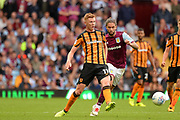 Hull City midfielder Sam Clucas (11) clears under pressure from Aston Villa midfielder Henri Lansbury (8) during the EFL Sky Bet Championship match between Aston Villa and Hull City at Villa Park, Birmingham, England on 5 August 2017. Photo by Dennis Goodwin.