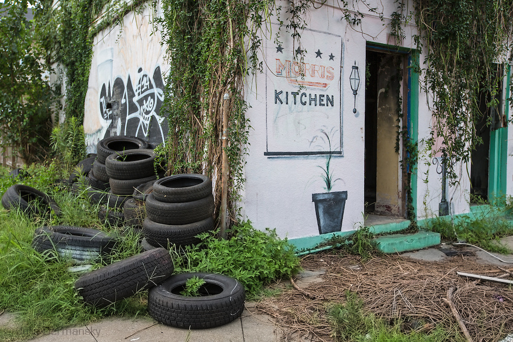 June 13, 2015, New Orleans, LA, Blighted vine covered building in mid-city.<br /> Properties destroyed by Hurricane Katrina, remain scattered around New Orleans nearly ten years after the storm.