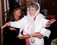 "Elena Monigold (left) turns an audience member into a 'mummy' during Mayhem & Mystery's production of ""Costume Carousing"" at the Spaghetti Warehouse in downtown Dayton, Monday, September 12, 2011."