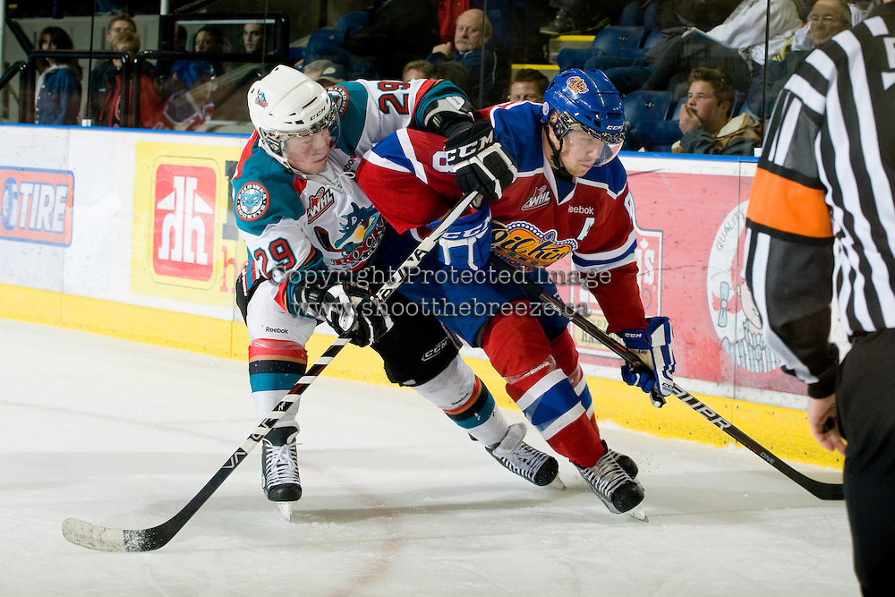 KELOWNA, CANADA, FEBRUARY 15: Myles Bell #29 o f the Kelowna Rockets checks Griffin Reinhart #8 of the Edmonton OIl Kings at the Kelowna Rockets on February 15, 2012 at Prospera Place in Kelowna, British Columbia, Canada (Photo by Marissa Baecker/Shoot the Breeze) *** Local Caption ***