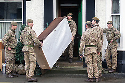 © Licensed to London News Pictures. 11/12/2015. Keswick UK. Soldiers from the 2nd Battalion Duke of Lancaster regiment are in Keswick today removing furniture from houses devastated by this weeks flooding. Photo credit: Andrew McCaren/LNP