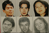 """AUM SHINRIKYO CULT CRIMINALS. Police """"wanted"""" poster for members of Aum Shinrikyo hangs on the platform wall on the Marunouchi subway line, one of the train lines attacked in the Sarin attack. Left to right the criminals are Hirata Makoto (left), Takahashi Katsuya (centre), Kikuchi Naoko (right). Takahashi and Kikuchi are """"wanted"""" for taking part in the 1995 Tokyo underground sarin gas attack by Aum Shinrikyo Supreme Truth Cult, in Tokyo, Japan"""
