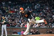 San Francisco Giants relief pitcher Hunter Strickland (60) pitches against the Oakland Athletics at AT&T Park in San Francisco, California, on March 26, 2018. (Stan Olszewski/Special to S.F. Examiner)