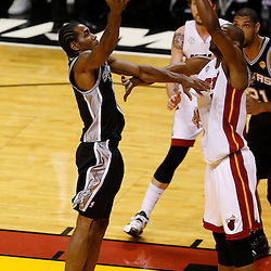 Jun 20, 2013; Miami, FL, USA; San Antonio Spurs small forward Kawhi Leonard (2) lays the ball up against Miami Heat center Chris Bosh (1) during the first quarter of game seven in the 2013 NBA Finals at American Airlines Arena. Mandatory Credit: Derick E. Hingle-USA TODAY Sports