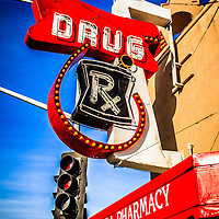 Photo of Balboa Pharmacy sign. Balboa Pharmacy is located at Main Street and Balboa Boulevard on Balboa Peninsula in Newport Beach California. Address is 716 East Balboa Boulevard, Newport Beach, CA 92661. Photo is high resolution.