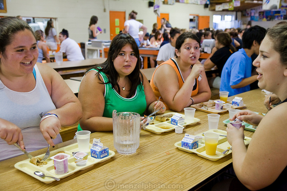 Mackenzie Wolfson at breakfast with her fellow campers during a weight loss program at Camp Shane in the Catskill Mountains, New York. (MacKenzie Wolfson is featured in the What I Eat: Around the World in 80 Diets.)  There are about 500 male and female campers housed in small cabins on shaded hillsides overlooking athletic fields, a small lake, and the camp's most important building, the cafeteria.