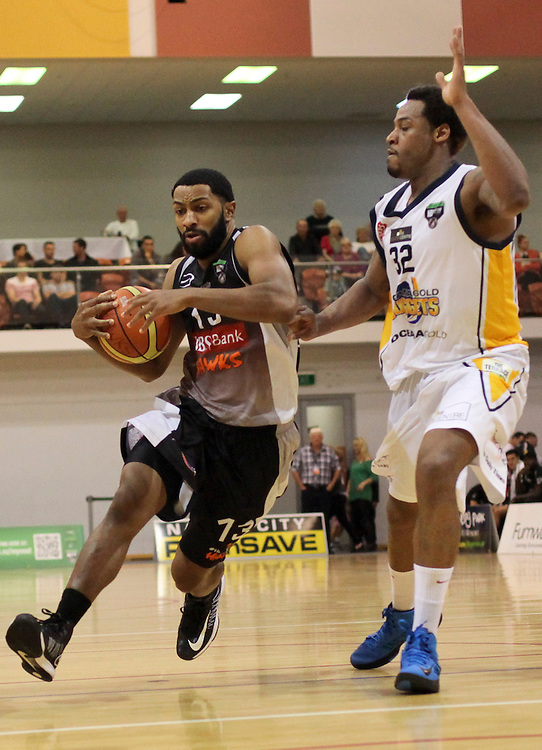 HBS Bank Hawks Dion Prewster, left, in action against Oceania Nuggets Antoine Tisby, National Basketball League, Pettigrew Green Arena, Napier, New Zealand, Saturday, April 27, 2013. Credit:SNPA / Bethelle McFedries