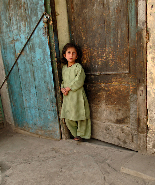 Afghan child in doorway.   (U.S. Air Force photo/Master Sgt. Lance Cheung)