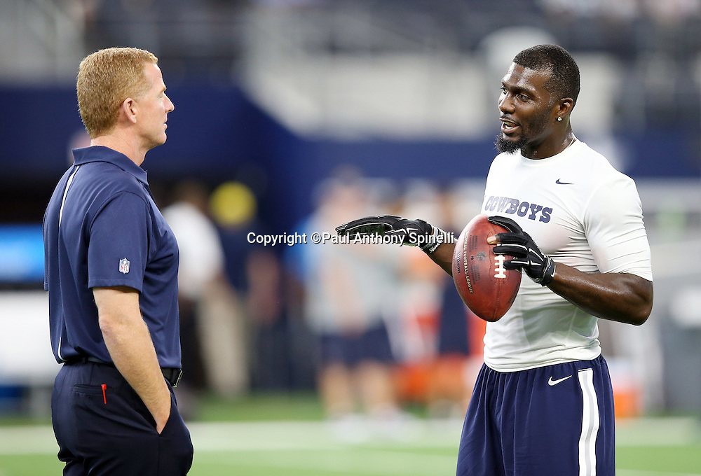 (L-R) Dallas Cowboys head coach Jason Garrett talks to Dallas Cowboys wide receiver Dez Bryant (88) before the 2015 NFL preseason football game against the Houston Texans on Thursday, Sept. 3, 2015 in Arlington, Texas. The Cowboys won the game 21-14. (©Paul Anthony Spinelli)