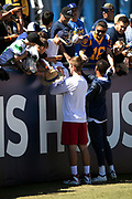 Arizona Cardinals rookie quarterback Josh Rosen (3) signs fan autographs after warming up before the 2018 NFL regular season week 2 football game against the Los Angeles Rams on Sunday, Sept. 16, 2018 in Los Angeles. The Rams won the game in a 34-0 shutout. (©Paul Anthony Spinelli)