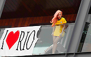 """08.NOVEMBER.2012. RIO DE JANEIRO<br /> <br /> LADY GAGA GREETS HER FANS IN A BRAZIL FOOTBALL SHIRT AND A BIG NOTE SAYING """"I LOVE RIO"""" BEFORE GETTING CHANGED INTO A BIKINI AT THE HOTEL FASANO IN RIO DE JANEIRO.<br /> <br /> BYLINE: EDBIMAGEARCHIVE.CO.UK<br /> <br /> *THIS IMAGE IS STRICTLY FOR UK NEWSPAPERS AND MAGAZINES ONLY*<br /> *FOR WORLD WIDE SALES AND WEB USE PLEASE CONTACT EDBIMAGEARCHIVE - 0208 954 5968*"""