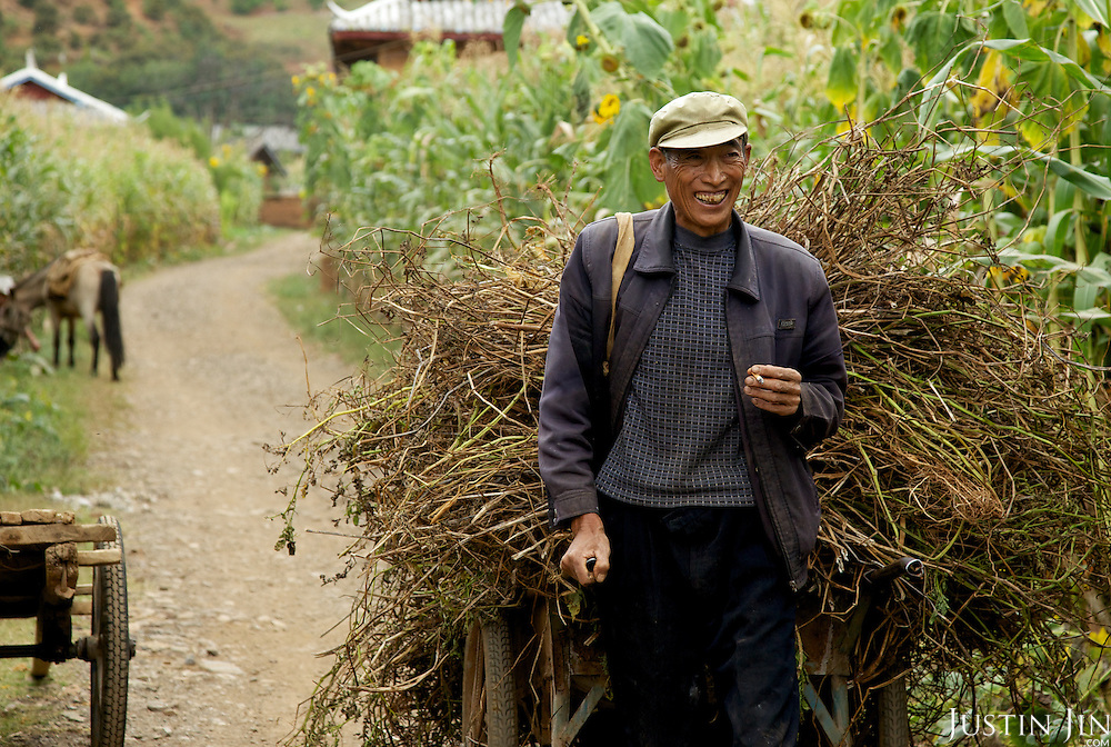 A farmer at the legendary Lugu Hu Lake in Sichuan Province, southwestern China.