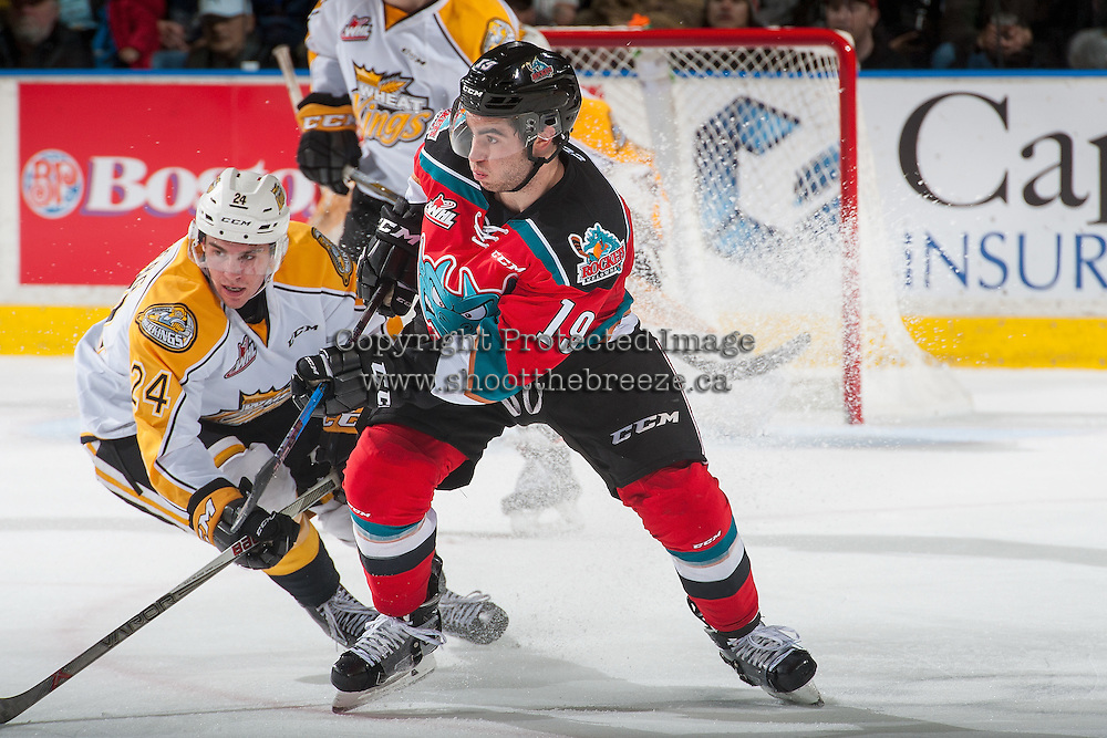KELOWNA, CANADA - DECEMBER 3: Connor Gutenberg #24 of the Brandon Wheat Kings checks Dillon Dube #19 of the Kelowna Rockets during second period on December 3, 2016 at Prospera Place in Kelowna, British Columbia, Canada.  (Photo by Marissa Baecker/Shoot the Breeze)  *** Local Caption ***