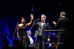 ANAHEIM, CA - JUN 9: Italian tenor Andre Bocelli performed Granada, New York, La Boheme, LaTraviata among others keeping audience mesmerized at the Honda Center in Anaheim, CA. The magical night included producer David Foster on Piano, Violinist Caroline Campbell, American Idol Season 3 winner Soul Singer Fantasia, Cuban Soprano Maria Aleida and Orchestra Conductor Eugene Kohn. Soul Singer Fantasia (L) performs with Italian tenor Andrea Bocelli (C) and Conductor Eugene Kohn (R). All fees must be agreed prior to publication, Byline and/or web usage link must  read  PHOTO: SilvexPhoto.com