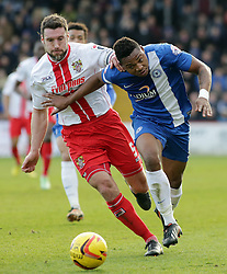 Peterborough United's Britt Assombalonga battles with Stevenage's Jon Ashton - Photo mandatory by-line: Joe Dent/JMP - Tel: Mobile: 07966 386802 22/02/2014 - SPORT - FOOTBALL - Stevenage - Broadhall Way - Stevenage v Peterborough United - Sky Bet League One