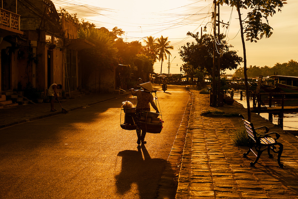 Woman carrying supplies to work in Hoi An