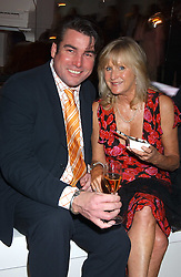 Chef ROSS BURDEN and LIZ BREWER at a summer party hosted by champagne house Krug held at Debbenham House, 8 Addison Road, London on 28th June 2005.<br />