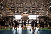 Newly hired employees walk past a Boeing Co. aircraft, as they leave the welcome ceremony of ANA Holdings Inc. at the company's hanger on April 1, 2017 in Tokyo, Japan. Japanese airlines ANA Holdings welcomed 2,800 new employees, the largest number to date for the company. As the majority of Japanese start their career on April 1st after graduating from schools in February or March, it is a custom for large Japanese corporations to hold mass welcoming ceremonies for their new employees.. 01/04/2017-Tokyo, JAPAN