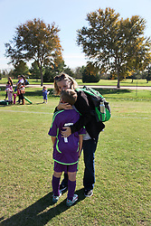 06 December 2015. Missouri City, Texas. <br /> Eclipse Soccer Club, 8th Annual Academy Cup - Toby Lazor Classic.<br /> New Orleans Jesters Youth Academy U10 Purple v ID Chelsea 06B. 2nd game.<br /> Chelsea win 4-0. <br /> End of the tournament. Ben is consoled by Michelle after missing a penalty.<br /> Photo©; Charlie Varley/varleypix.com