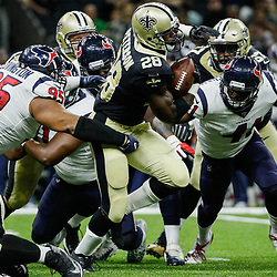 Aug 26, 2017; New Orleans, LA, USA; New Orleans Saints running back Adrian Peterson (28) runs through tackle attempts by Houston Texans defensive end Christian Covington (95) and linebacker Zach Cunningham (41) during the second quarter of a preseason game at the Mercedes-Benz Superdome. Mandatory Credit: Derick E. Hingle-USA TODAY Sports