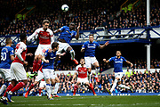 Everton defender Kurt Zouma (5) clears the danger from Arsenal defender Nacho Monreal (18) during the Premier League match between Everton and Arsenal at Goodison Park, Liverpool, England on 7 April 2019.