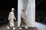 Models walk down the catwolk wearing dresses of Miaoran fashion designer at Armani Teatro, Milan June 18, 2016. © Carlo Cerchioli