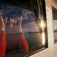 USA, Alaska, First mate Ken Grieg on bridge of Arco Juneau oil tanker at sunset
