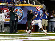 Florida RB Percy Harvin highsteps into the end zone for a TD during the SEC Championship game between the Arkansas Razorbacks and the Florida Gators at the Georgia Dome in Atlanta, GA on December 2, 2006.<br />
