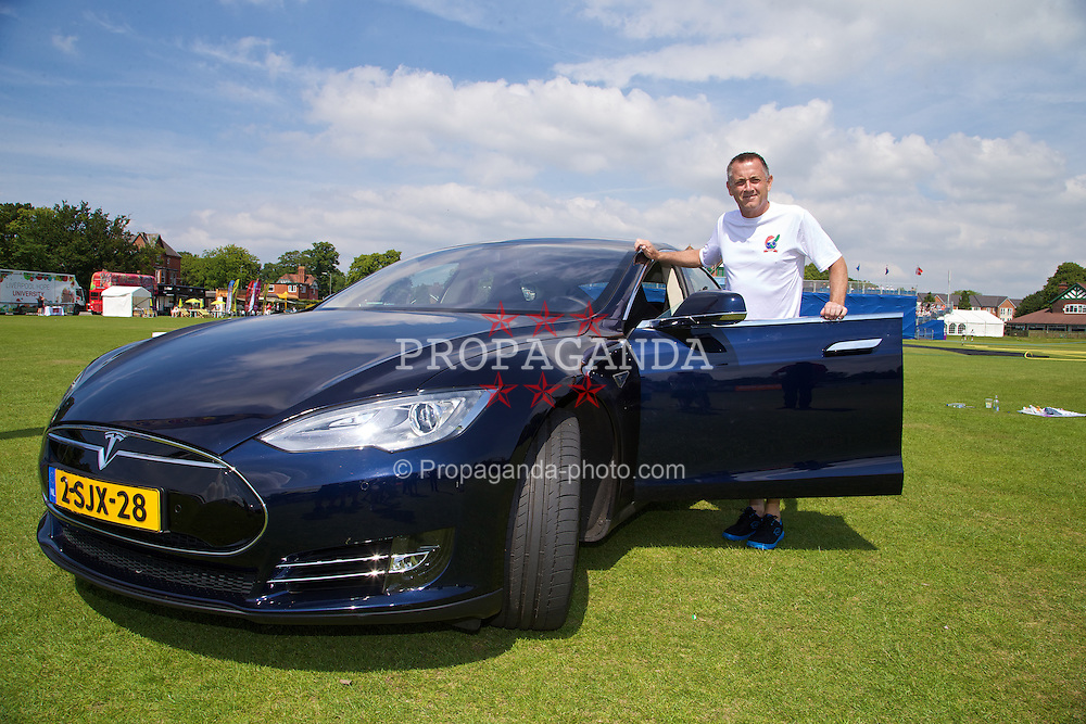 LIVERPOOL, ENGLAND - Sunday, June 22, 2014: Mikael Pernfors with the Tesla Model S all electric car during Day Four of the Liverpool Hope University International Tennis Tournament at Liverpool Cricket Club. (Pic by David Rawcliffe/Propaganda)