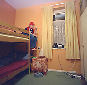 Boy sitting on his bunk bed, Cardiff 2000's