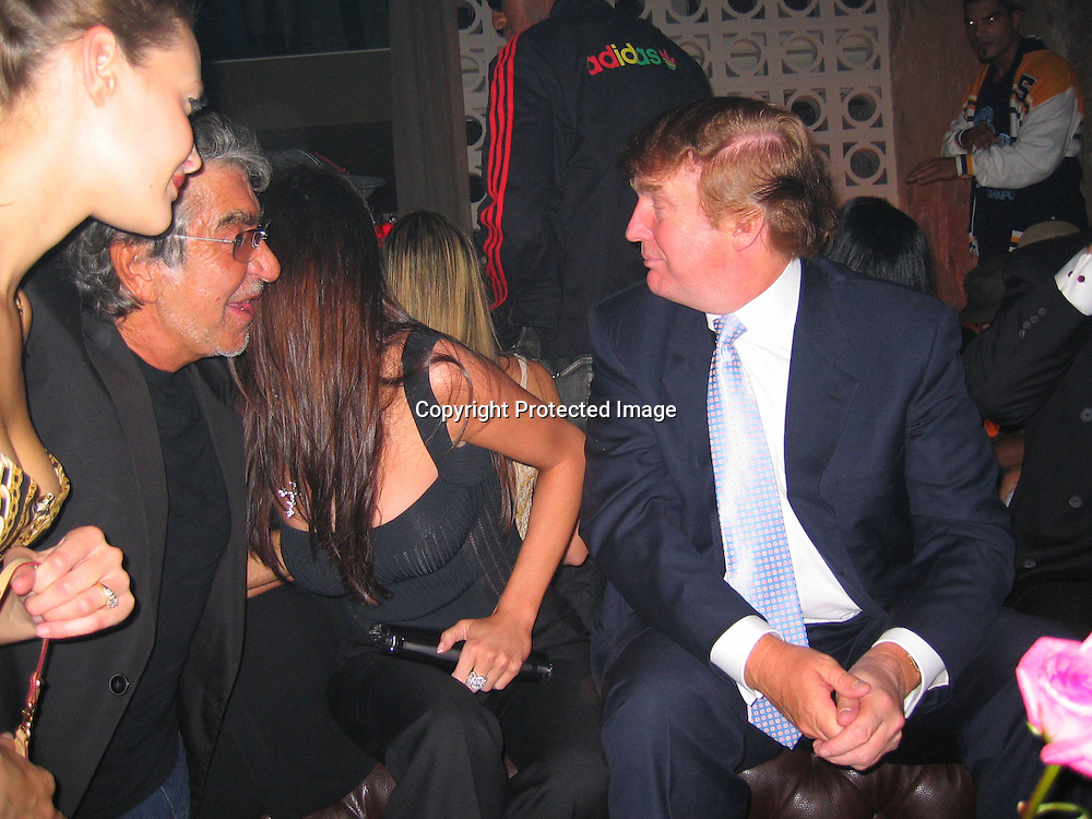 Roberto Cavalli, Melania Knauss &amp; Donald Trump<br />Rosa Cha Post Party Hosted By Naomi Campbell<br />PM Lounge<br />New York City, NY, USA<br />Saturday, September, 13, 2003<br />Photo By Celebrityvibe.com/Photovibe.com