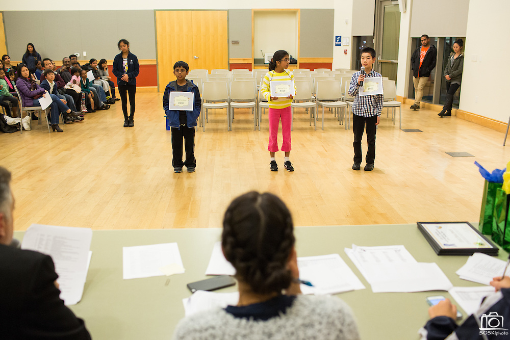 Yixuan Qiao, right, spells a word while other fourth through sixth grade competitors wait during the 2016 Milpitas Youth Spelling Bee at the Milpitas Senior Center in Milpitas, California, on January 22, 2016. (Stan Olszewski/SOSKIphoto)