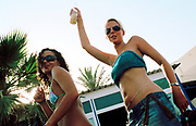 Two female clubbers enjoying themselves at Bora Bora Bar, Ibiza 2005
