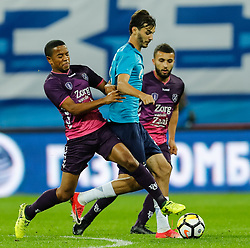 August 24, 2017 - Saint Petersburg, Russia - Aleksandr Erokhin (C) of FC Zenit Saint Petersburg vies for the ball with Urby Emanuelson (L) of FC Utrecht and Zakaria Labyad of FC Utrecht during the UEFA Europa League play-off round second leg match between FC Zenit St. Petersburg and FC Utrecht at Saint Petersburg Stadium on August 24, 2017 in Saint Petersburg, Russia. (Credit Image: © Mike Kireev/NurPhoto via ZUMA Press)