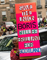 Edinburgh, Scotland, UK. 29 July 2019. Prime Minister Boris Johnson meets Scotland's First Minister Nicola Sturgeon at Bute House in Edinburgh on his visit to Scotland. Pro Boris Johnson supporter hold sign.