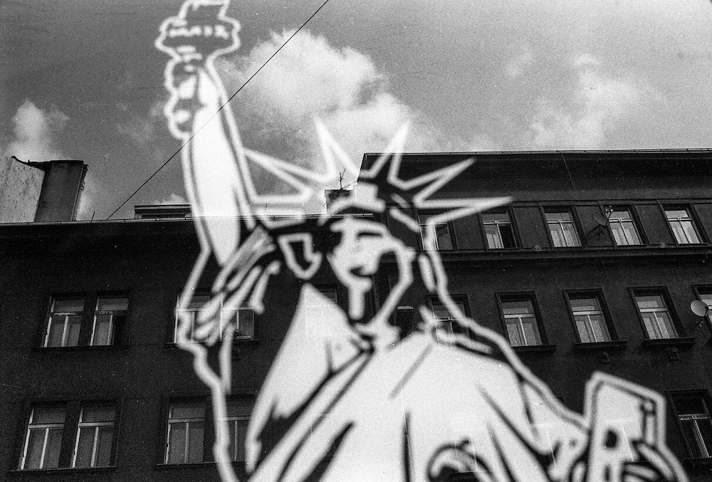 The Statue of Liberty glued to a mirror of a sex shop in Zizkov.