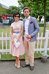 EVA LANSKA and DAVID GIGAURI at the launch of Chelsea Thoroughbreds held at St.Luke's Church, Sydney Street, London on 2nd July 2014.