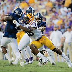 Aug 31, 2019; Baton Rouge, LA, USA; LSU Tigers linebacker K'Lavon Chaisson (18) sacks Georgia Southern Eagles quarterback Shai Werts (1) during the second quarter at Tiger Stadium. Mandatory Credit: Derick E. Hingle-USA TODAY Sports
