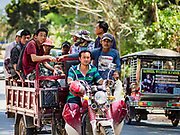 "15 FEBRUARY 2019 - SIHANOUKVILLE, CAMBODIA: Chinese construction workers in Sihanoukville are shuttled to their job site in a large tuk-tuk. There are about 80 Chinese casinos and resort hotels open in Sihanoukville and dozens more under construction. The casinos are changing the city, once a sleepy port on Southeast Asia's ""backpacker trail"" into a booming city. The change is coming with a cost though. Many Cambodian residents of Sihanoukville  have lost their homes to make way for the casinos and the jobs are going to Chinese workers, brought in to build casinos and work in the casinos.     PHOTO BY JACK KURTZ"