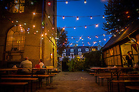 Copenhagen, Denmark- JULY 25, 2014: The courtyard at the Lidkoeb. Located in the Vesterbro neighborhood, Lidkoeb is a cocktail bar hidden away in an alley in a refurbished chemists building. CREDIT: Chris Carmichael for The New York Times