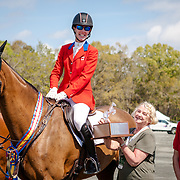 Selena O'Hanlon (CAN) and Foxwood High, winners of the CCI4*-S at the Red Hills International Horse Trials in Tallahassee, Florida with horse owners, John and Judy Rumble.